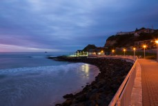 Dawn breaks over the Hot Saltwater Pool at St Clair Beach, Dunedin, New Zealand.