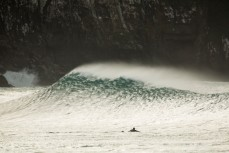 Sam Guthrie watches a perfect wave break in the Catlins south of Dunedin, New Zealand.