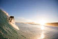 Limited Edition: A surfer drops into a wave on dusk at Blackhead Beach, Dunedin, New Zealand.