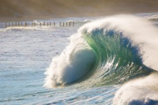 Backwash hits wild surf at St Clair Beach, Dunedin, New Zealand.