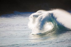 Backwash in wild surf at St Clair Beach, Dunedin, New Zealand.