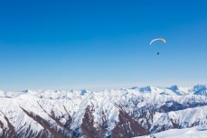 Freedom as a paraskier floats above the backcountry at Cardrona Alpine Resort, Wanaka, New Zealand.