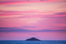 White Island at dusk at St Kilda Beach, Dunedin, New Zealand.
