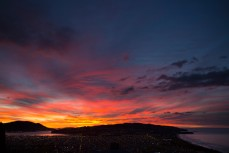 Sunrise over South Dunedin and Otago Peninsula, Dunedin, New Zealand.
