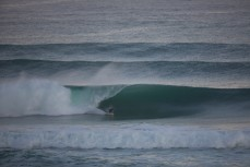 Heath Ratten bottom turns into a large, hollow wave at St Kilda Beach, Dunedin, New Zealand.