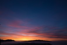 Sunrise over Otago Harbour and Otago Peninsula, Dunedin, New Zealand.