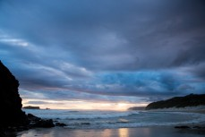 Stormy skies over Smaills Beach, Dunedin, New Zealand.