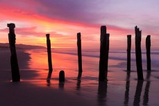 Dawn over the St Clair Poles at St Clair Beach, Dunedin, New Zealand.