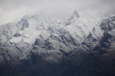 The Remarkables dusted in fresh snow as seen from Cecil Peak Station, Lake Wakatipu, New Zealand.