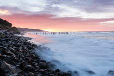 St Clair poles at dawn, St Clair Beach, Dunedin, New Zealand.