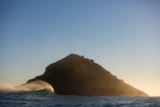 An empty wave peels through on a remote reef break on the Otago coast, New Zealand.