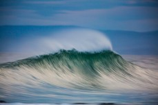 A feathering wave during a pushy swell at Blackhead Beach, Dunedin, New Zealand.