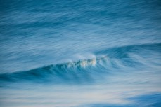 Speed blur in fun, rampy waves at Blackhead Beach, Dunedin, New Zealand.