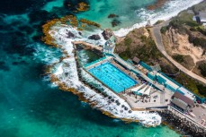 Aerial shots of the Dunedin coastline, St Clair Hot Salt Water Pool, Dunedin, New Zealand.