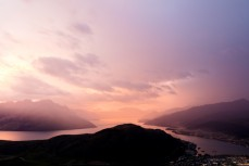 Sunset as weather arrives over Lake Wakatipu and Queenstown, Central Otago, New Zealand.